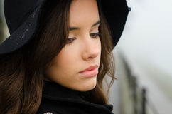 Portrait of beautiful young girl in black outdoor on misty autumn day royalty free stock photos