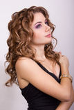 Portrait of a beautiful young girl with brown curly hair Stock Photography