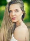 Portrait of beautiful young girl with clean skin on pretty face Stock Images