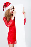 Portrait of a beautiful young girl with closed eyes in santa hat Royalty Free Stock Photos