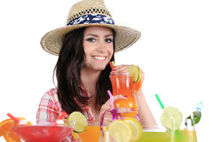 Portrait of a beautiful young girl with cocktail Stock Images