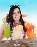 Portrait of a beautiful young girl with cocktail Stock Photo