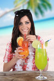 Portrait of a beautiful young girl with cocktail Royalty Free Stock Photos