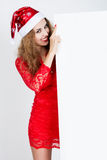 Portrait of a beautiful young girl with curly hair in Santa hat Stock Image