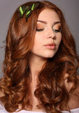 Portrait of beautiful young girl with curly red hair stock photos