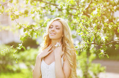 Portrait beautiful young girl. Eyes closed enjoying summer, cute smile, freshness, spring, nature - concept Stock Image