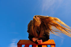 Portrait of beautiful young girl with flying hair. Royalty Free Stock Photo