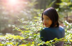 Young girl in the forest. Portrait of a beautiful young girl in the forest Royalty Free Stock Photography