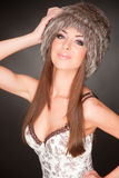 Portrait of beautiful young girl in furry hat Royalty Free Stock Photo