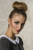 Portrait of a beautiful young girl with hair in retro style make-up showing Stock Photo