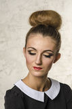 Portrait of a beautiful young girl with hair in retro style make-up showing Royalty Free Stock Photos