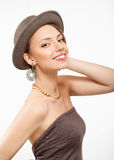 Portrait of beautiful young girl in hat. Portrait of a beautiful girl with clean fresh skin in hat, looking at camera and smiling Royalty Free Stock Photography