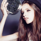 Portrait of a beautiful young girl in a hat with disco ball Royalty Free Stock Photo