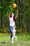 Portrait of Beautiful young girl with her dogs Royalty Free Stock Photos