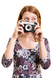 Portrait of a beautiful young girl holding a camera Royalty Free Stock Image