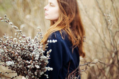 Portrait of a beautiful young girl with a huge armful of willow Royalty Free Stock Images