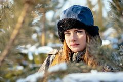 Portrait of a beautiful young girl while hunting in a winter pin stock photo