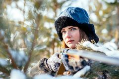 Portrait of a beautiful young girl while hunting in a winter pin stock photos