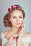 Portrait of the beautiful young girl in an image of the bride with ornament in hair Royalty Free Stock Images