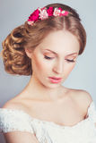 Portrait of the beautiful young girl in an image of the bride with ornament in hair. Portrait of the beautiful young girl looking down in an image of the bride Stock Photography