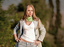 Portrait of beautiful young girl in jeans outdoor Royalty Free Stock Image