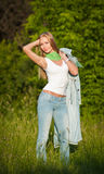 Portrait of beautiful young girl in jeans outdoor Stock Photography