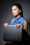 Portrait of a beautiful young girl with laptop Stock Image