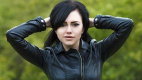 Portrait of a beautiful young girl in a leather jacket on the background of autumn nature stock photos