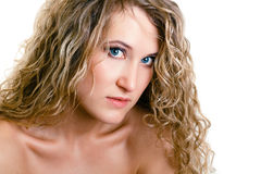 Portrait of a beautiful young girl with long blond wavy hair Royalty Free Stock Photos