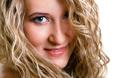 Portrait of a beautiful young girl with long blond wavy hair Stock Image