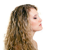 Portrait of a beautiful young girl with long blond wavy hair Royalty Free Stock Images