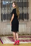 Portrait of beautiful young girl with long hair in black dress a royalty free stock photography
