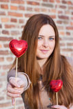 Portrait of a  beautiful young girl offering a heart. Looking for love, selective focus Stock Photography