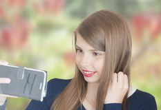 Portrait of beautiful young girl with phone Royalty Free Stock Images