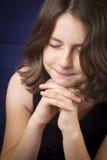 Portrait of beautiful young girl praying Stock Photos