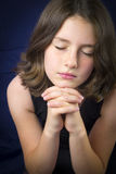 Portrait of beautiful young girl praying Stock Photo