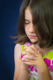 Portrait of beautiful young girl praying Royalty Free Stock Photography