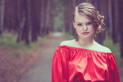 Portrait of a beautiful young  girl in a red dress outdoors Royalty Free Stock Image