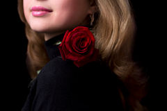 Portrait of a beautiful young girl with a red rose Royalty Free Stock Photo
