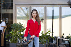 Portrait of a beautiful young girl in red shirt on the backgroun Stock Photo