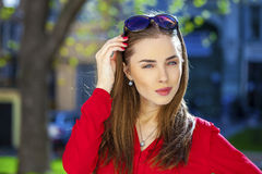 Portrait of a beautiful young girl in red shirt on the backgroun Royalty Free Stock Images