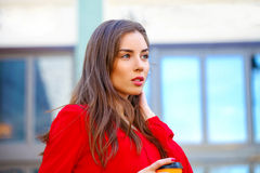 Portrait of a beautiful young girl in red shirt on the backgroun Royalty Free Stock Photography