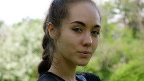 Portrait of a beautiful young girl, slow motion. European model woman model posing and turning on camera. stock video