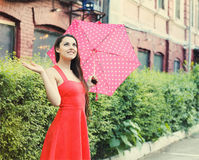 Portrait of beautiful young girl walking with umbrella Stock Photo