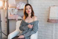 Portrait of a beautiful young girl in a white knit sweater, winter, comfort, warmth, lifestyle, hair, makeup Royalty Free Stock Photos