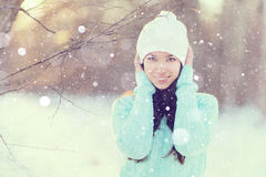 Portrait of a beautiful young girl in winter nature Royalty Free Stock Image