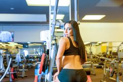 Portrait of a beautiful young girl working out in the Gym Royalty Free Stock Photo