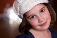 Portrait of a beautiful young girl in a woven hat. Portrait of a beautiful young child in a woven hat looking at camera Royalty Free Stock Photography
