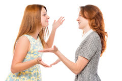 Portrait of a beautiful young girlfriends arguing Stock Image