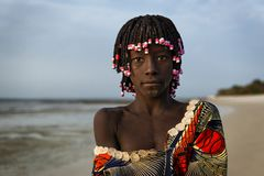 Portrait of a beautiful young girlr in the beach in the island of Orango at sunset. Orango Island, Guinea-Bissau - February 2, 2018: Portrait of a beautiful stock photos